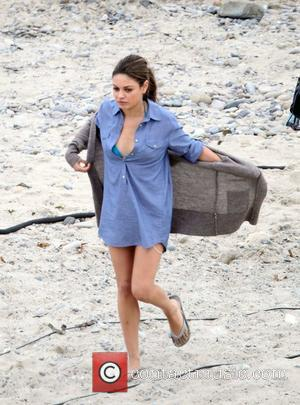 Mila Kunis filming 'Friends with Benefits' on location at a beach Los Angeles, California - 07.09.10