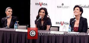 Kourtney Kardashian, Kim Kardashian and Kris Jenner speaks during a press conference announcing the 'Kardashian Khaos' store opening at the...