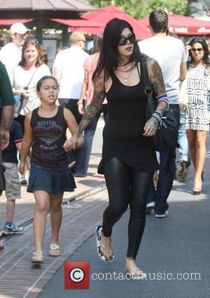 American tattoo artist Kat Von D and a young companion head to the Cheesecake Factory in the Grove in Hollywood...