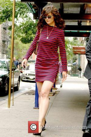 Katie Holmes leaving her Manhattan apartment wearing a striped dress New York City, USA - 19.07.10