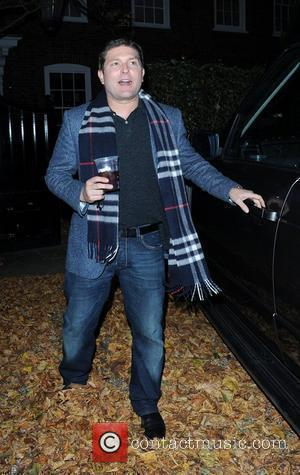 George Michael's partner, Kenny Goss, outside the star's home  George Michael has regained his freedom after he was released...