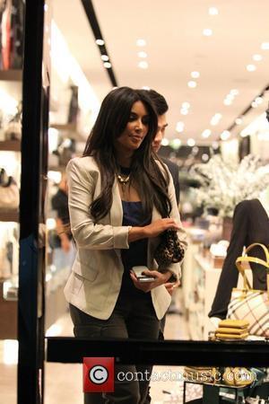 Kardashian Laughs Off West Pregnancy Rumours