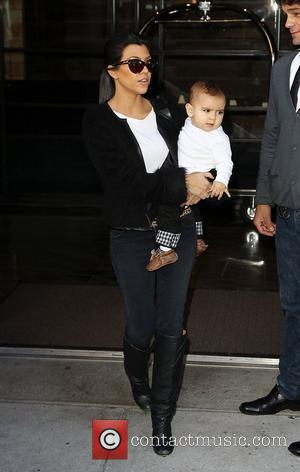 Kourtney Kardashian carrying her son Mason as she arrives at JFK Airport New York City, USA - 13.10.10