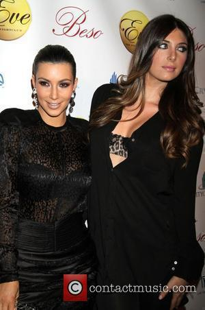 Kardashian Laughs Off $10,000 Tweets