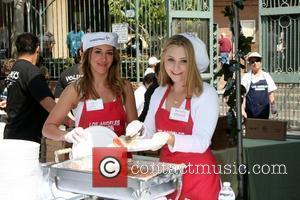 Haylie Duff and Beverly Mitchell  Los Angeles Easter Meal for the homeless at the LA Mission Los Angeles, California...