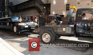A Tow truck removes a limousine which displays the seal of the president of the united states outside The Ed...