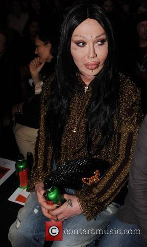 Pete Burns  London Fashion Week Spring/Summer 2011 - Vivienne Westwood - Front Row, Catwalk and Backstage London, England -...