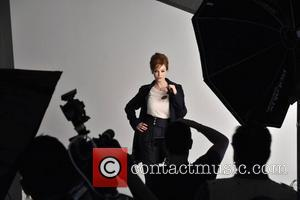 Christina Hendricks Lends Sex Appeal To London Fog