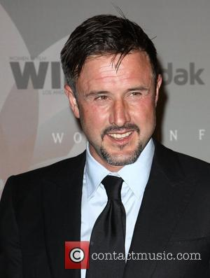 Arquette Dismisses Reports Of Marriage Trouble