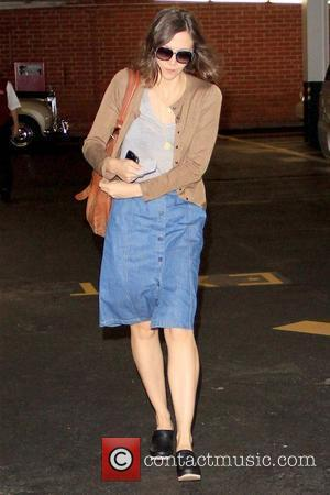 Maggie Gyllenhaal arriving at a medical centre while wearing a button-down denim skirt and black clogs Los Angeles, California -...