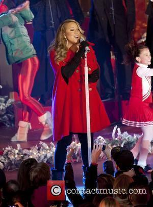 Carey Rings In Holidays With Star-studded Charity Concert