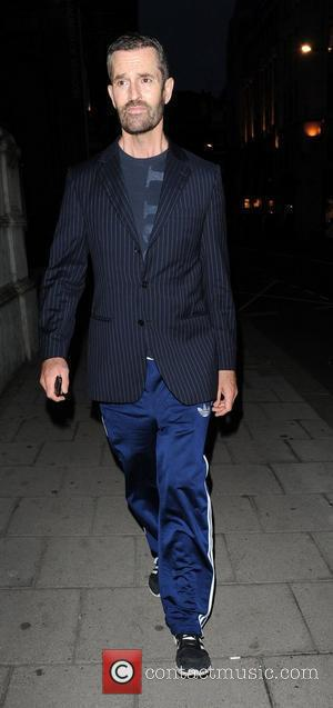 Rupert Everett in tracksuit bottoms and jacket arriving at the Martina Rink book launch of 'Isabella Blow' held at the...