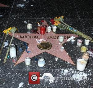 Michael Jackson's star on The Hollywood Walk of Fame on the 1st anniversary of his death Los Angeles, USA -...