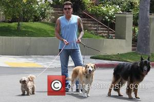 Billy Ray Cyrus walks his dogs near his home in Toluca Lake Los Angeles, USA - 11.07.10