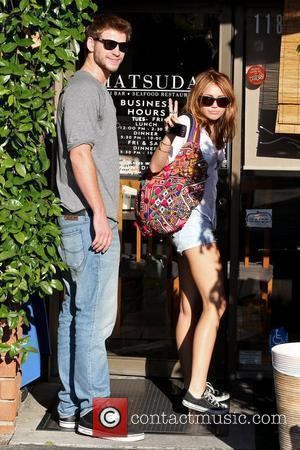 Miley Cyrus and boyfriend Liam Hemsworth arrive at Matsuda restaurant in Studio City Los Angeles, California - 24.06.10