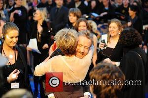 Emma Thompson gives Rhys Ifans the 2 fingers followed by a big hug.  'Nanny McPhee And The Big Bang'...