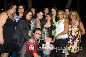Fans of Olga Tanon surprise her with a birthday cake on the set of the first broadcast of her monthly...