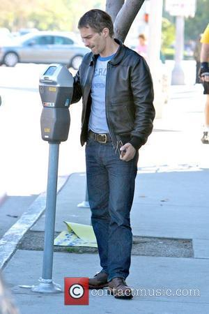 Olivier Martinez feeding a parking meter while out running errands Los Angeles, California - 09.10.10