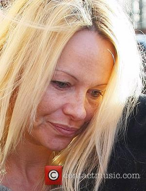 Pamela Anderson  arrives at the New Wimbledon Theatre looking disheveled and without make-up. She tried to avoid showing her...