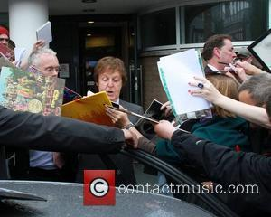 Sir Paul McCartney is mobbed by fans as he leaves the LIPA Graduation ceremony at the Philharmonic Hall.  Liverpool,...