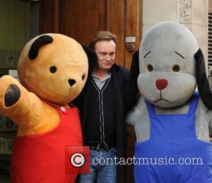Philip Glenister outside the BBC Radio 1 studios with U.K. TV characters Sooty and Sweep  London, England - 01.04.10