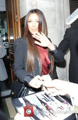Kardashian's Pricey Parisian Purses