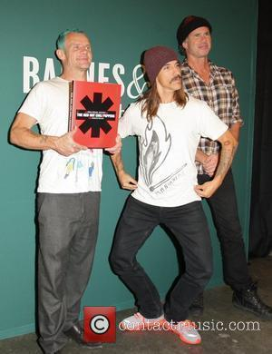 Flea aka Michael Peter Balzary, Anthony Kiedis and Chad Smith Red Hot Chili Peppers promote their new book 'The Red...