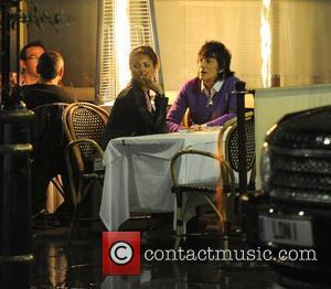 Ronnie Wood and his girlfriend Ana Araujo pop outside for a cigarette break, during a meal together at a restaurant...