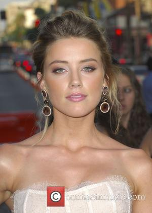 Amber Heard attending the L.A. movie premiere of 'Salt' at the Grauman Chinese Theatre - Arrivals Hollywood, California - 19.07.10