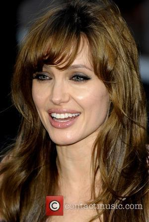 Jolie Hoping To Impress Kids With Action Movies