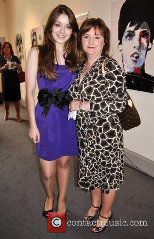 Sarah Bolger and her mother Monica Bolger Irish actress Sarah Bolger is presented with her portrait by artist Katarzyna Gajewska...