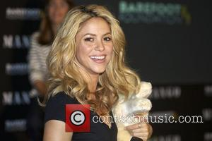 Shakira Visits South African School