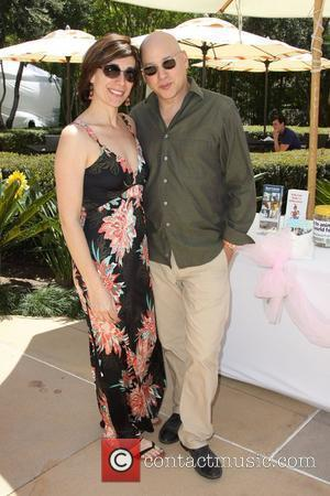 Evan Handler and his wife Elisa Atti Annual Dog And Baby Buffet Mother's Day Event at the Hyatt Regency Century...