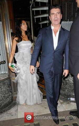 Simon Cowell and A Female Companion Leaving Mr Chows Restaurant