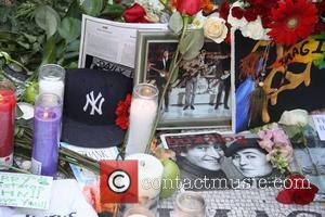 Mourners gather to sing and pay tribute at Strawberry Fields' 'Imagine' mosaic to mark the 30th Anniversary of John Lennon's...