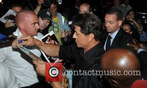 Sylvester Stallone is mobbed by autograph hunters as he arrives back at The Dorchester Hotel after attending the UK film...