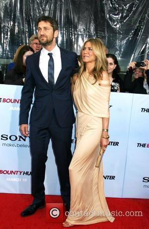 Gerard Butler and Jennifer Aniston Premiere of 'The Bounty Hunter' at Ziegfeld Theatre - Arrivals New York City, USA -...