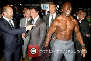Jason Statham, Sylvester Stallone, Dolph Lundgren and Terry Crews, who took of his shirt for photographers The cast of 'The...