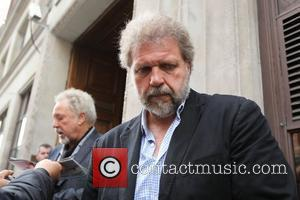 Tom Jones and his son Mark Woodward outside the BBC Radio One studios London, England - 27.07.10