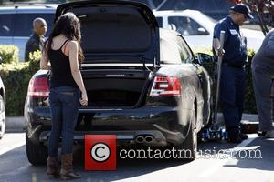 Vanessa Hudgens returns to her car after shopping, to find it has a flat tire.  Los Angeles, California -...