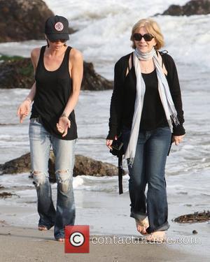 Victoria Beckham and Sandra Beckham walking on the beach Malibu, USA - 31.01.10