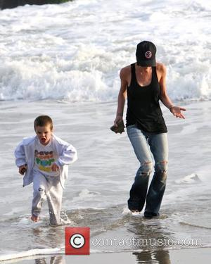 Victoria Beckham and Cruz Beckham playing on the beach and getting their feet wet in the water Malibu, USA -...