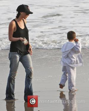 Victoria Beckham and Cruz Beckham playing on the beach Malibu, USA - 31.01.10
