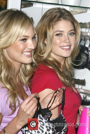 Candice Swanepoel and Doutzen Kroes Victoria's Secret supermodels celebrate the reveal of the 2010 'What Is Sexy?' List: Bombshell Edition...