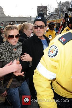 Charlie Sheen and his goddess Bree Olson leave his hotel and walk to Massey Hall as part of his...