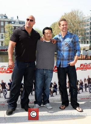 Dwayne Johnson, aka The Rock, Director, Justin Lin and Paul Walker attend a Photocall for Fast & Furious 5: Rio...