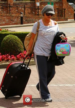 Kerry Katona  leaves her mother's house with her daughter to head for a local hotel to pick up her...