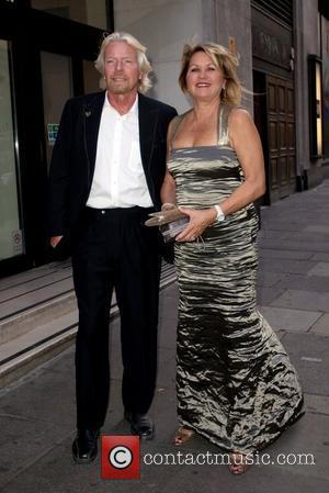 Richard Branson and his wife Joan Branson arriving at his party at the Kensington Roof Gardens London, England - 21.04.11