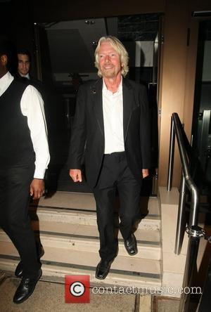 Richard Branson leaving his party at the Kensington Roof Gardens London, England - 21.04.11