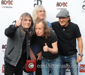 Malcolm Young, Cliff Williams, Angus Young and Brian Johnson of AC/DC Premiere of 'AC/DC - Live at River Plate' at...